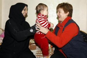 Visit by Kristalina Georgieva, Member of the EC in charge of International Cooperation, Humanitarian Aid and Crisis Response to Jordan. (EC Audiovisual Services). A baby and a happy mother are basics on occasions like that.  God knows what happens to them next.