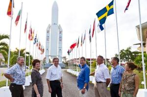 Joël Barre, Director of the Guianese Space Centre and Deputy Chief Operating Officer of the Centre National Français d'Etudes Spatiales, 3rd from the left, and Johannes Hahn, Member of the EC in charge of Regional Policy 4th from the left, showing the model of the Ariane rocket.