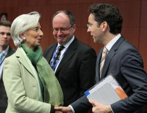 Happy meeting between Christine Lagarde, Managing Director of the IMF (on the left) and Jeroen Dijsselbloem, President of the Eurogroup, in the foreground. Eurogroup 15/03/2013, (Council of the European Union Photographic Library).