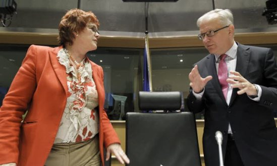 Exchange of views with Olli Rehn, Vice-President of the EC in charge of Economic and Monetary Affairs and the Euro (on the right), in the Committee on Economic and Monetary Affairs of the European Parliament, photographed here with Sharon Bowles (ALDE, UK), chair of the Committee. (European Parliament photographic library).