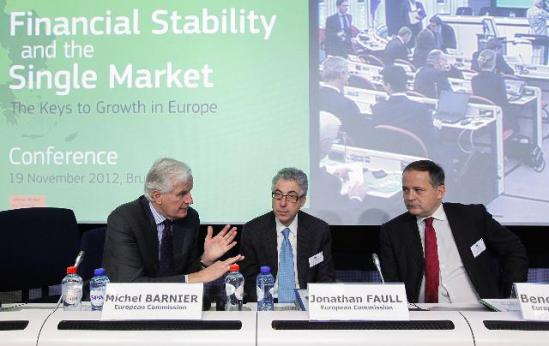 "Michel Barnier, Member of the European Commission in charge of Internal Market and Services, Jonathan Faull, Director General of the DG ""Internal Market and Services"" of the EC, and Benoît Cœuré, Member of the Executive Board of the European Central Bank (ECB) (from left to right) at the conference ""Financial Stability and the Single Market – The Keys to Growth in Europe"". (EC Audiovisual Services)."