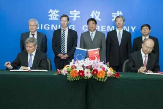 Signature of the letter of intent regarding fighting counterfeiting in trade in alcoholic beverages by Zhi Shuping, Minister of the Administration of Quality Supervision, Inspection and Quarantine the People's Republic of China (AQSIQ) on the right, and Dacian Cioloș, Member of the EC in charge of Agriculture and Rural Development on official visit to China on the left. EU Agricultural products are easy targets in trade disputes, due to the huge subsidies the EU pays to its farmers. China has already singled out European wines for being heavily subsidised with public money. (EC Audiovisual Services, 23/07/2013).