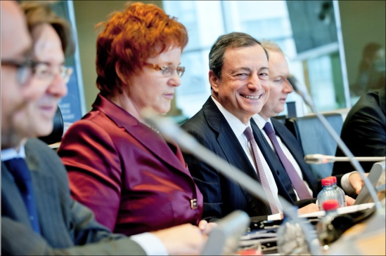 Mario Draghi, European Central Bank President and Chairman of the European Systemic Risk Board (looking at the camera) speaking at the hearing of the Economic and Monetary Affairs Committee (ECON) of the European Parliament. Next to him, in the chair of ECON Committee, Sharon Bowles (ALDE, UK). (European Parliament, Audiovisual Services, 23/9/2013).