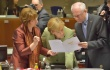 Herman van Rompuy, President of the European Council and Catherine Ashton, High Representative of the Union for Foreign Affairs and Security Policy and Vice-President of the Commission (on the left) are both holding a document for the Angela Merkel, the German Federal Chancellor (in the middle), to read. (EC Audiovisual Services, 28/6/2013).  After Merkel's electoral triumph yesterday the German leader would expect more such favours while in Brussels.