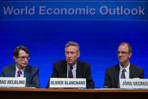 (C) International Monetary Fund Economic Counsellor and Director of the Research Department, Olivier Blanchard, (L) Division Chief, Research Department Thomas Helbling, and (R) Deputy Director of the Research Department, Jӧrg Decressin during a press briefing on the World Economic Outlook during the 2013 World Bank/IMF Annual Meetings, October 8, 2013 at the IMF Headquarters in Washington, DC. IMF Staff Photograph/ Michael Spilotro.