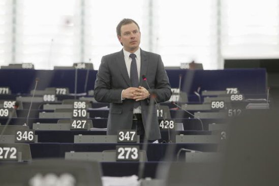 """A not so plenary session in the European Parliament (week 11, 2013). Discussion on """"Integration of migrants, its effects on the labour market and the external dimension of social security coordination"""". MEP Piotr Borys (EPP-Poland) has the floor in a deserted room."""