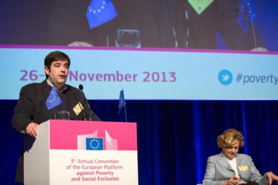 """The Third Annual Convention of the Platform against Poverty and Social Exclusion took place on 26-27 November 2013 in Brussels. Sergio Aires, President of The European Anti-Poverty Network, at the podium in the presence of Lieve Fransen, Director at the DG """"Employment, Social Affairs and Inclusion"""" of the European Commission. (EC Audiovisual Services 26/11/2013)."""