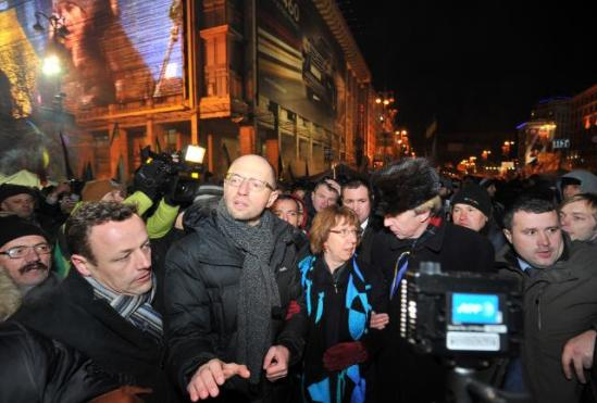 "Catherine Ashton, High Representative of the Union for Foreign Affairs and Security Policy and Vice-President of the European Commission, went to Kyiv where she met with Viktor Yanukovych, President of Ukraine. The Vice-President then visited the protest camp in Maidan Nezalezhnosti (Independence Square) with Arseniy Yatsenyuk, Member of the Ukrainian Parliament and Leader of the ""Fatherland"" Party, and Volodymyr Ohryzko, former Ukrainian Minister for Foreign Affairs. In the picture Arseniy Yatsenyuk, Catherine Ashton and Volodymyr Ohryzko, surrounded by the crowd during their visit of the protest camp (in the foreground, in the centre, from left to right). (EC Audiovisual Services, 10/12/2013)."