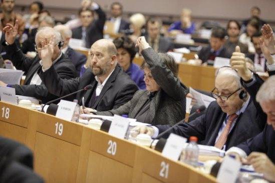 """European Parliament. Committee on Economic and Monetary Affairs (ECON) meeting, on """"Eurozone banks supervision regime"""". (In the forefront) Marino Baldini (S&D, HR) (second from left), Elisa Ferreira (S&D, PT), (third from left), Jean-Paul Gauzes, (EPP, FR) (second from right). Vote by a show of hands. (EP Audiovisual Services, 17 Dember 2013)."""