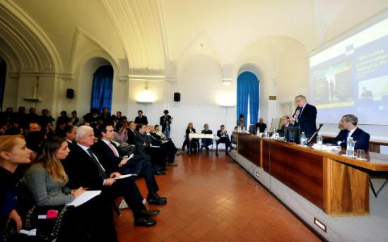 Antonio Tajani, Vice-President of the European Commission in charge of Industry and Entrepreneurship (addressing the audience from the panel table), travelled to Rome to participate in the launch of the Raw Materials University Day, at the Sapienza University. The initiative was organised in the framework of the communication strategy of the European Innovation Partnership (EIP) on Raw Materials, which aimed to promote sectorial competitiveness, sustainable growth and employment by showing the huge potential of European raw materials. (EC Audiovisual Services, 06/12/2013).