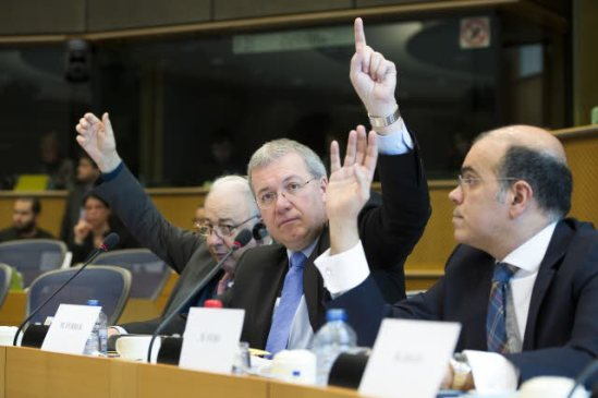 European Parliament. Committee on Economic and Monetary Affairs (ECON) meeting. Voting by raise of hands. From left to right, Jean-Paul Gauses (EPP, FR), Markus Ferber (EPP, DE), Diogo Feio (EPP, PT). (EP Audiovisual Services, 30/1/2014).