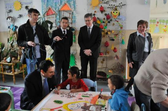 László Andor, Member of the EC in charge of Employment, Social Affairs and Inclusion, had a trip to Košice (Slovakia) where he visited Hrebendova 5 kindergarten located in the Romani borough of Luník IX. Peter Pollák, Plenipotentiary Minister of the Slovak Government for Roma Communities, crouched on the left, in the front, talking to a schoolgirl, in the presence of a member of the press, Tomáš Minárik, the interpreter, László Andor and Anna Klepáčová, director of Hrebendova 5 kindergarten, standing in the background from left to right. After the politicians went away the usual misery returned to this rundown region. (EC Audiovisual Services, 23/04/2014).