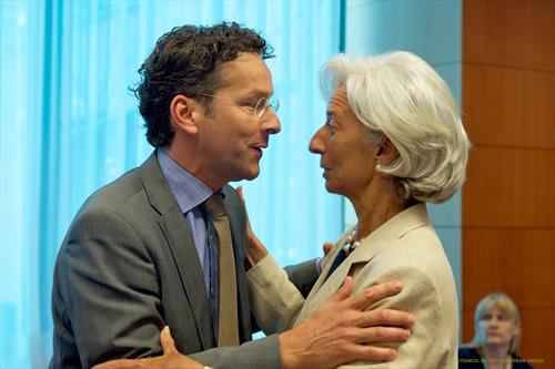 A close embrace between Jeroen Dijsselbloem, President of the Eurogroup and Christine Lagarde, Managing Director of the IMF (from left to right). So close yet so far apart, after the IMF started criticizing Eurozone about fiscal and incomes austerity and an overleveraged banking sector. (The Council of the European Union, 8/7/2013).