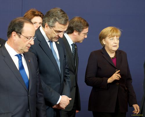 European Council. From left to right: Francois Hollande, President of France, Antonis Samaras, Greek Prime Minister, Pedro Passos Coelho, Portuguese Prime Minister, Angela Merkel, German Federal Chancellor. It's clear that Angela Merkel instructs the Portuguese PM and the Francois Hollande gives directions to the Greek Premier. (Council of the European Union, 20/03/2014).