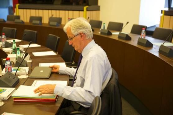 Michel Barnier, Vice-President of the EC in charge of Internal Market and Services and Industry and Entrepreneurship (pro term), seated, reading documents (EC Audiovisual Services, 1/07/2014)
