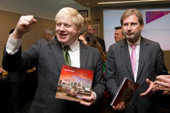"Boris Johnson, Mayor of London, on the left, and Johannes Hahn, presenting the brochure entitled ""The Crystal: a sustainable cities initiative by Siemens"", EC Audiovisual Services,  28/02/2014"