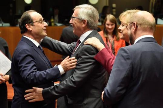 Embrace between François Hollande, President of the French Republic, and Jean-Claude Juncker, President of the European Commission as from 01/11/2014 in the presence of Angela Merkel, German Federal Chancellor, and Martin Schulz, President of the European Parliament (in the foreground, from left to right). European Council of Brussels, 23-24/10/2014. Discussions focused on getting the right balance in the EU's approach on the Economy so it could stimulate growth and reduce unemployment. (EC Audiovisual Services, 23/10/2014).
