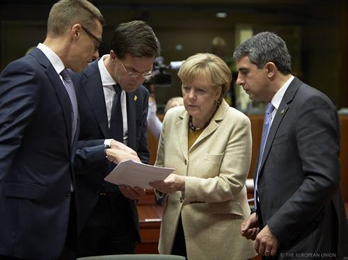 European Council of 24/10/2014. From left to right: Alexander Stubb, Finnish Prime Minister, Mark Rutte, Dutch Prime Minister, Angela Merkel, German Federal Chancellor and Rosen Plevneliev, President of Bulgaria. The Finn and the Dutch leaders show the German Chancellor a document, while the Bulgarian politician doesn't dare touch it. (The Council of the European Union photographic librery).