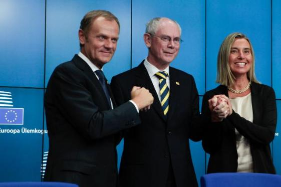 Handshake between Donald Tusk, Herman van Rompuy and Federica Mogherini (from left to right) during the end of the August Council where Mr Tusk got the top EU job. (EC Audiovisual Services, 30/08/2014)