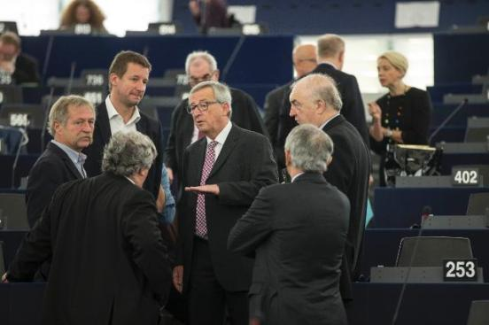 Jean-Claude Juncker, President of the European Commission (in the middle of a group of MEPs), and several Members of the College of the Commission participated in the European Parliament plenary session which focused on the presentation of the creation of a new EU strategic investment plan. (EC Audiovisual Services, 26/11/2014).
