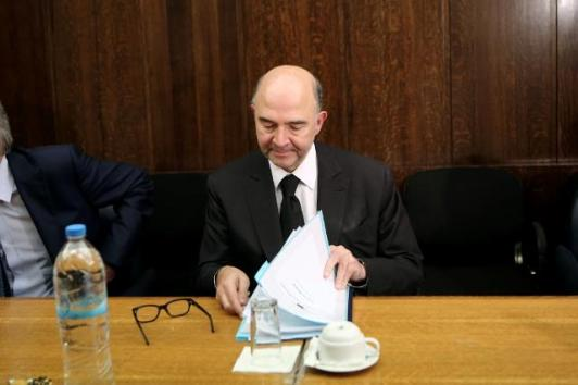 Even the Commissioner would have a very tough time going through the pile of paperwork on the new digital VAT in Europe. Pierre Moscovici, Member of the EC in charge of Economic and Financial Affairs, Taxation and Customs, in this picture embarked on a visit to Athens where he met with Antonis Samaras, Greek Prime Minister, and other Greek officials. (EC Audiovisual Services, 15/12/2014)