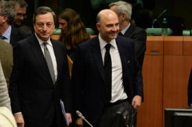 Eurogroup meeting of 20/02/2015. Mario Draghi, President of the European Central Bank (ECB), and Pierre Moscovici Member of the EC in charge of Economic and Financial Affairs, Taxation and Customs (in the foreground, from left to right), participated in that crucial meeting with the 19 of Eurozone Ministers for Finance. They all agreed to consider extending financial assistance to Greece, which was formally known as the Master Financial Assistance Facility Agreement, granted by the European Financial Stability Facility (EFSF). Discussions took place in the context of the expiry of the financial assistance to Greece due on 28/02/2015. (EC Audiovisual Services).