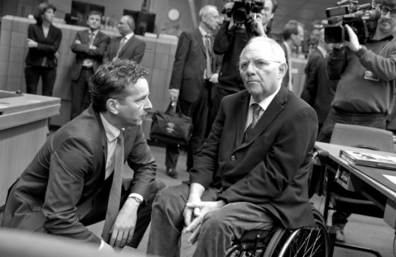 "Dijsselbloem to Schauble: ""Wolfgang, just think for a moment; I think we are making a tremendous mistake with Greece""; this could or should be Mr Dijsselbloem's saying to Mr Schauble yesterday afternoon during the Eurogroup gathering in Brussels. The photo is black and white probably because it will be one that will endure in the European history books of the future to open the ""pandora box"" EU chapter. From left to right, Jeroen Dijsselbloem, Dutch Finance Minister of Finance and Wolfgang Schauble, German Minister of Finance, during yesterday's historic Eurogroup meeting in Brussels (EU Council TV Newsroom, 16/02/2015)"