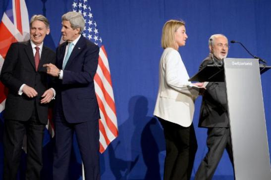 (L-to-R) British Foreign Secretary Philip Hammond, US Secretary of State John Kerry, Federica Mogherini, High Representative of the EU for Foreign Affairs and Security Policy and Iranian Foreign Minister Mohammad Javad Zarif. Mogherini and Zarif walk to deliver the famous Press conference of 02/04/2015, where they confirmed the eventual return of Iran to the world community. (EC Audiovisual Services. Lausanne, 2/4/2015).