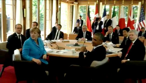 Roundtable of the G7 Summit, on 7 June 2015, in Schloss Elmau, Germany. From left to right, François Hollande, French President, David Cameron, British Prime Minister, Angela Merkel, German Chancellor,  Matteo Rentzi, Italian Prime Minister, Jean Claude Juncker, EU Commission President, Barack Obama, President of US, Donald Tusk, European Council President, Shinzō Abe, Japanese Prime Minister, Stephen Harper, Prime Minister of Canada. (European Council – Council of the European Union Audiovisual Library, Snapshot from a video footage, Shoot date: 07/06/2015, Location: Schloss Elmau, Germany 7.6.2015).
