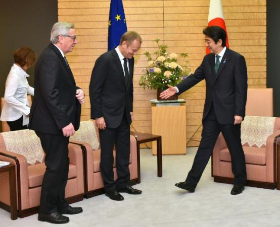 Jean-Claude Juncker, President of the European Commission (first from left) and Donald Tusk, President of the European Council, bending his head a bit more than what the protocol demands (in the middle) participated in the at the 23rd EU-Japan Summit, which took place in Tokyo. In this instance they meet with the Japanese prime minister Shinzo Abe. (European Commission Audiovisual Services, 29/05/2015, Tokyo).