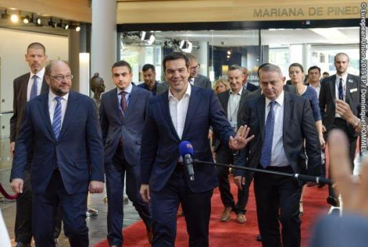 The Prime Minister of Greece Alexis Tsipras (waving a hand) paid yesterday an official visit to the European Parliament. The president of the legislative welcomed the Greek leader and directed him to the plenary. (European Parliament Audiovisual Services, Event Date: 08/07/2015, City: Strasbourg, Copyright: © European Union 2015 EP).