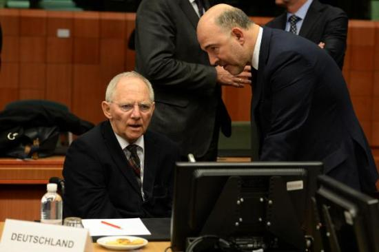 Discussion between Wolfgang Schäuble, German Federal Minister for Finance, on the left, and Pierre Moscovici, Member of the European Commission in charge of Economic and Financial Affairs, Taxation and Customs. They both participate in the meetings of Eurogroup, the key decision-making body in the Eurozone. These two men are by far the most influential persons in the euro area. (EC Audiovisual Services).