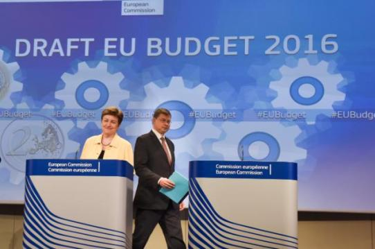 Kristalina Georgieva Vice-President of the European Commission in charge of Budget and Human Resources on the left and Valdis Dombrovskis, Vice-Presidents of the EC, walking to take his position in the rostrum delivered a joint press conference on the conclusions of the weekly meeting of the Juncker Commission, which had focused on the EU Budget for 2016. (EC Audiovisual Services, 27/05/2015, Brussels – European Commission/Berlaymont).