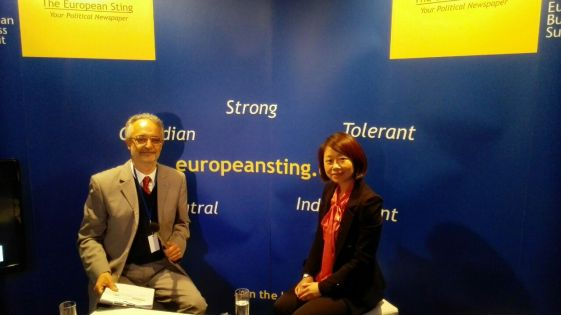 Mrs Xiaoyan Jiang is the Spokesperson of the Mission of the People's Republic of China to the European Union. Mrs Xiaoyan is depicted in the photo together with the European Sting's Editor in Chief, Mr Dennis Kefalakos, during the live interview taken at the Sting's pavilion in European Business Summit 2015.