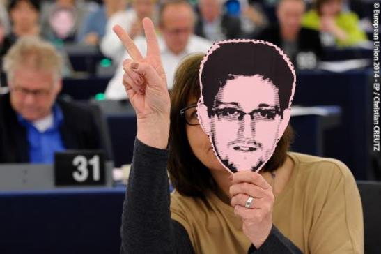 Photo in action on NSA scandal/asylum for Snowden. MEPs wearing mask of Snowden (© European Union 2014 - EP)