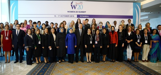 ISTANBUL, TURKEY - OCTOBER 16: Turkish President Recep Tayyip Erdogan (C), his wife Emine Erdogan (L-6), Family and Social Affairs Minister Aysen Gurcan (L-5) and President of W20 Turkey Gulden Turktan (R-6) pose with participants during the Women-20 (W20) Summit in Istanbul, Turkey on October 16, 2015. Yasin Bulbul/Turkish Presidency Press Office / Anadolu Agency