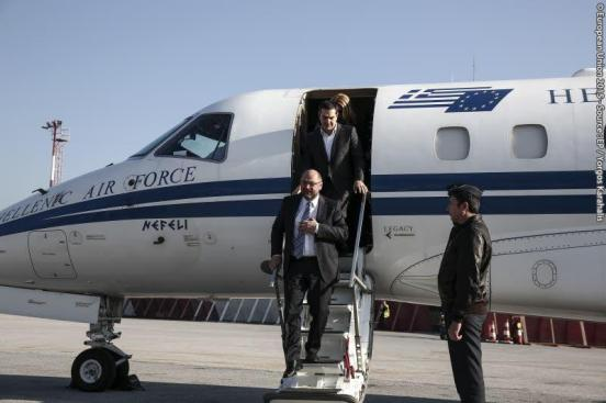 WOW: Martin Schulz here disembarks the luxurious Greek LearJet and is about to witness LIVE one single wrecked boat packed with refugees at the port of Lesvos islands in the Aegean sea. Behind him Alexis Tsipras, the young Greek Premier who is delighted to give Schulz a ride to the sunny islands (European Parliament Audiovisual Services, 05/11/2015)