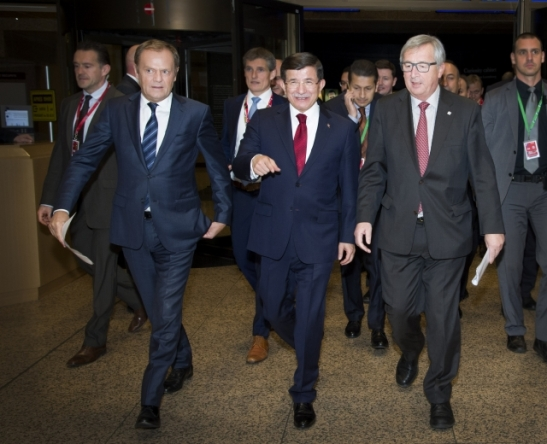 The EU heads of state or government met with the Turkish Prime Minister Ahmet Davutoglu (in the middle) in the European Council of 29 November. After the meeting Donald Tusk, President of the European Council (first from left), Davutoglu and Jean-Claude Juncker, President of the European Commission held a Press conference. (Shoot location: Brussels – Belgium. Shoot date: 29/11/2015. Copyright credit 'The European Union').