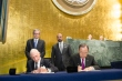 Summit for Refugees and Migrants, Signing Ceremony of UN-IOM Agreement During the opening of the UN Summit for Refugees and Migrants, Secretary-General Ban-Ki Moon seated right) and William Lacy Swing (seated left), Director General of the International Organization for Migration (IOM), sign the agreement to make the IOM a Related Organization of the UN.  Date: 19/09/2016. Location: United Nations, New York. Copyright © 2016 United Nations. Photo:Rick Bajornas
