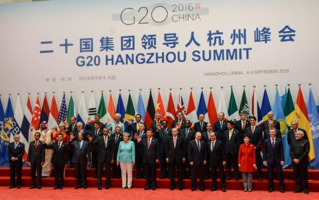 G20 Summit in Hangzhou, China. Group photo, from left to right, in the 1st row: Michel Temer, President of Brazil, Joko Widodo, President of Indonesia, Enrique Peña Nieto, President of Mexico, Jacob Zuma, President of South Africa, Barack Obama, President of the United States, Angela Merkel, German Federal Chancellor, Xi Jinping, President of the People's Republic of China, Recep Tayyip Erdoğan, President of Turkey, Vladimir Putin, President of Russia, François Hollande, President of the French Republic, Park Geun-hye, President of South Korea, Mauricio Macri, President of Argentina, and Narendra Modi, Indian Prime Minister, in the 2nd row: Mohammed bin Salman, Vice-Prince of Saudi Arabia and Saudi Arabian second Deputy Prime Minister, Theresa May, British Prime Minister, Malcolm Turnbull, Australian Prime Minister, Matteo Renzi, Italian Prime Minister, Bounnhang Vorachith, President of Laos, Noursoultan Nazarbaïev, President of Kazakhstan, Idriss Déby, President of the African Union and President of Chad, Macky Sall, President of Senegal, Abdelfatah Khalil al-Sisi, President of Egypt, Shinzō Abe, Japanese Prime Minister, Justin Trudeau, Canadian Prime Minister, Donald Tusk and Jean-Claude Juncker, in the 3rd row: Mark Carney, Chairman of the Financial Stability Board, Roberto Azevêdo, Director-General of the World Trade Organization (WTO), Christine Lagarde, Managing Director of the International Monetary Fund (IMF), Prayut Chan-o-cha, Thai Prime Minister, Lee Hsien Loong, Singaporean Prime Minister, Mariano Rajoy Brey, Spanish Prime Minister, Ban Ki-moon, Secretary General of the United Nations, Jim Yong Kim, President of the World Bank, Guy Ryder, Director-General of the International Labour Organization (ILO), and Angel Gurría, Secretary General of the Organisation for Economic Co-operation and Development (OECD). (Date: 04/09/2016. Location: Hangzhou. © European Union, 2016 / Source: EC - Audiovisual Service/ Photo: Etienne Ansotte).