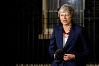 British PM Theresa May makes statement on Brexit at Downing Street, on completion of her Cabinet meeting. Taken on November 14, 2018. Some right reserved.