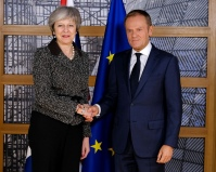 British Prime Minister Theresa May travelled to the Brussels to meet with the President of the EU Council, Donald Tusk. Not even thin smiles there. Taken on December 11, 2018. UK government photo, Some rights reserved.